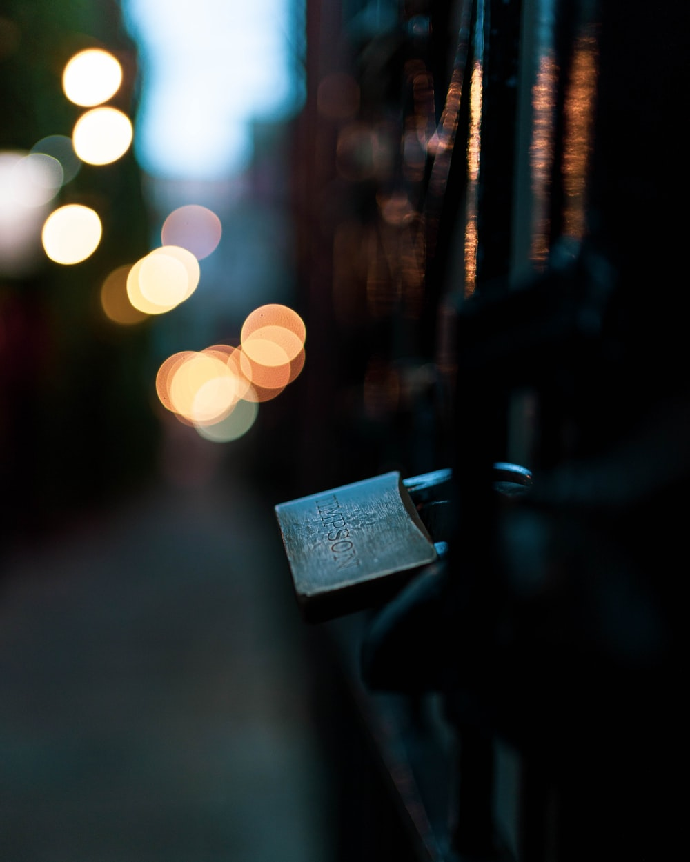 selective focus photography of padlock on fence
