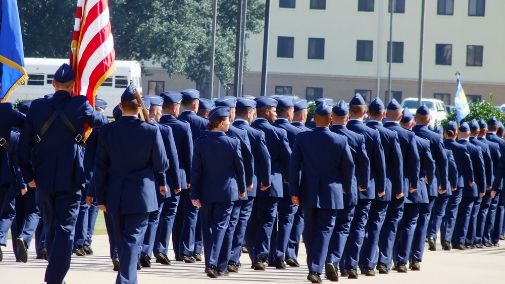 parade of troop in blue formal attire