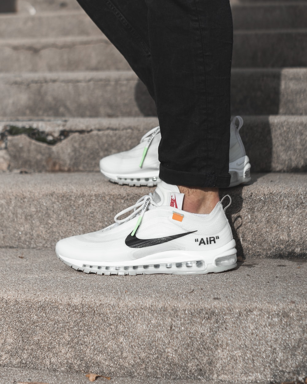 white-and-black Nike shoes