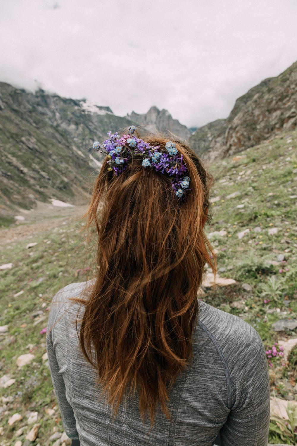 back view of woman with purple floral hairpiece