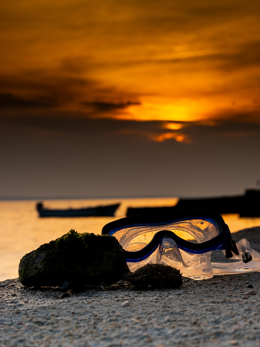 snorkeling goggles on sand dunes during golden hour