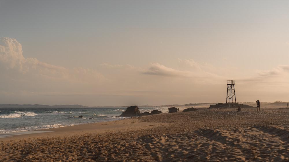 seashore across metal tower