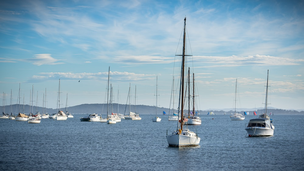 sailboats on body of water during daytime