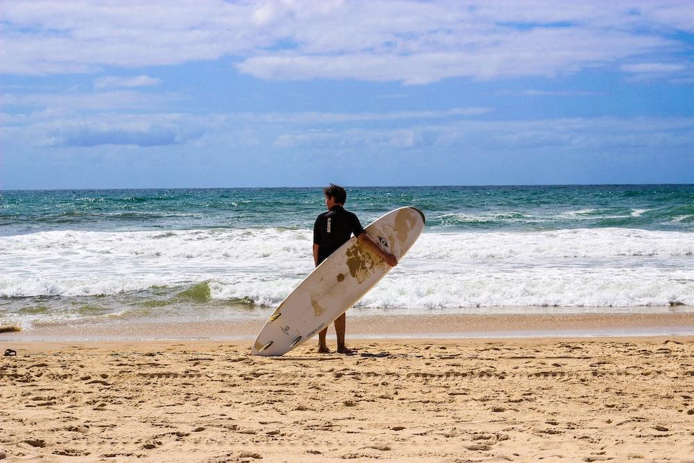 man holding surfingboard