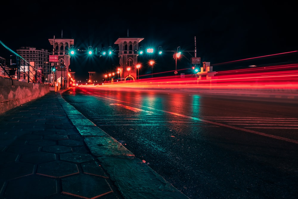 gray concrete road during nighttime