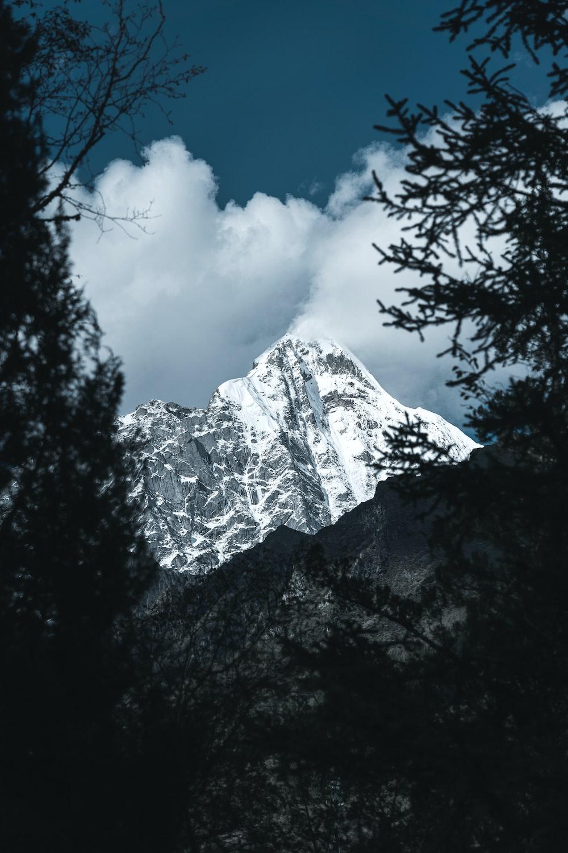 white mountain across white clouds