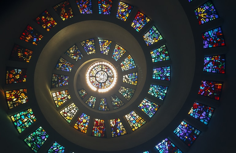 decorative image. Spiral of stained glass windows.