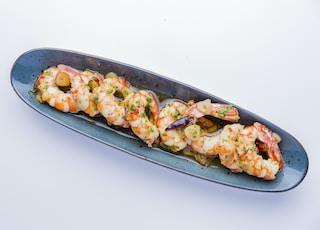 shrimp dish in gray oblong plate