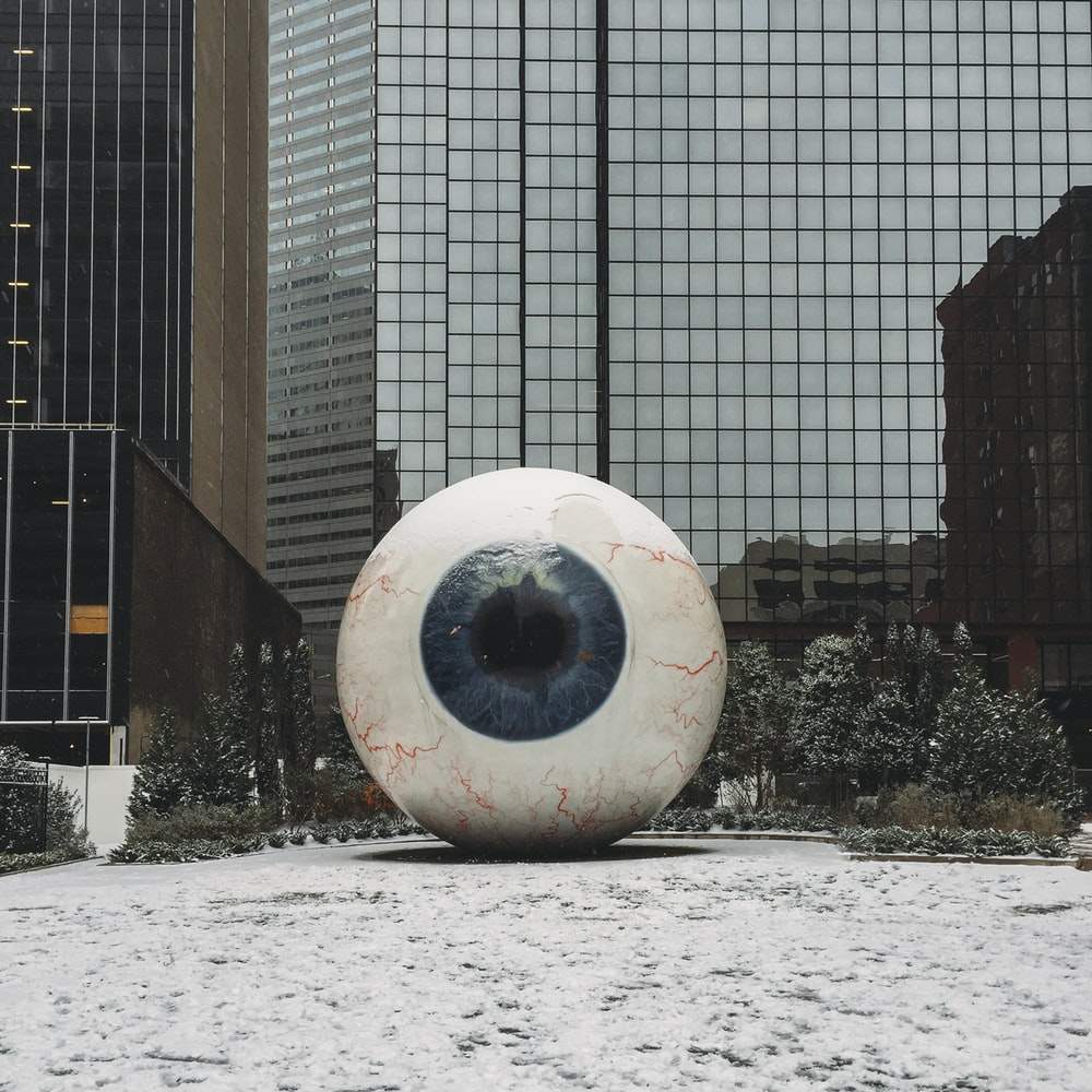 white and blue eye state in front of building