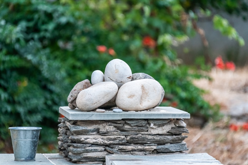 pile of stones near cup