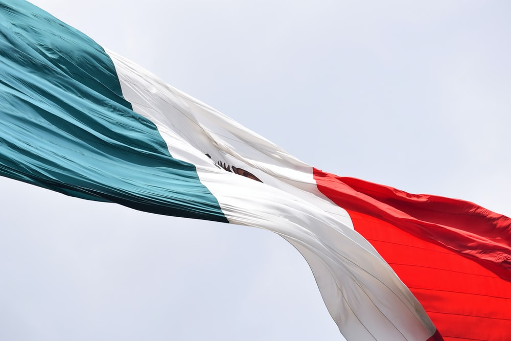 waving Mexico flag during daytime