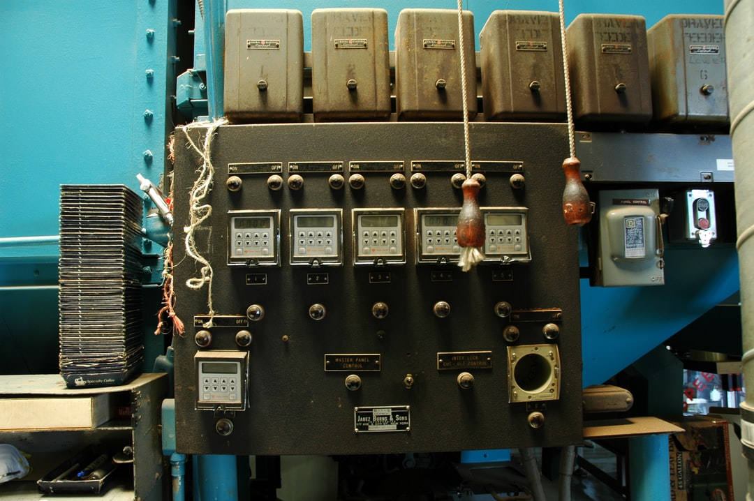 Coffee roasting equipment, dials, Master Panel Control, Inter Lock Cut off control, panel control, Draver feeders & drivers, Jabez, Burns & Sons full system coffee roaster control panel, in operation, blue wall, Los Angeles, California, USA
