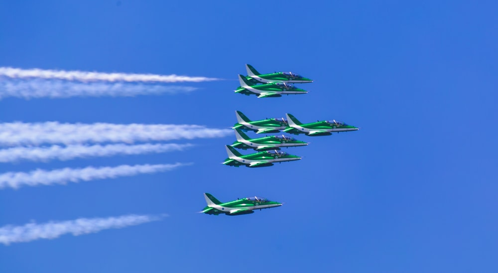 green airplanes in sky