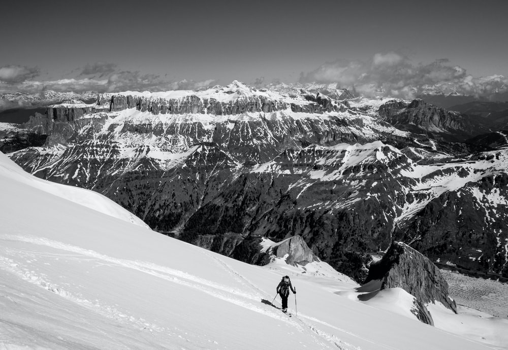 man on top of snow capped mountain