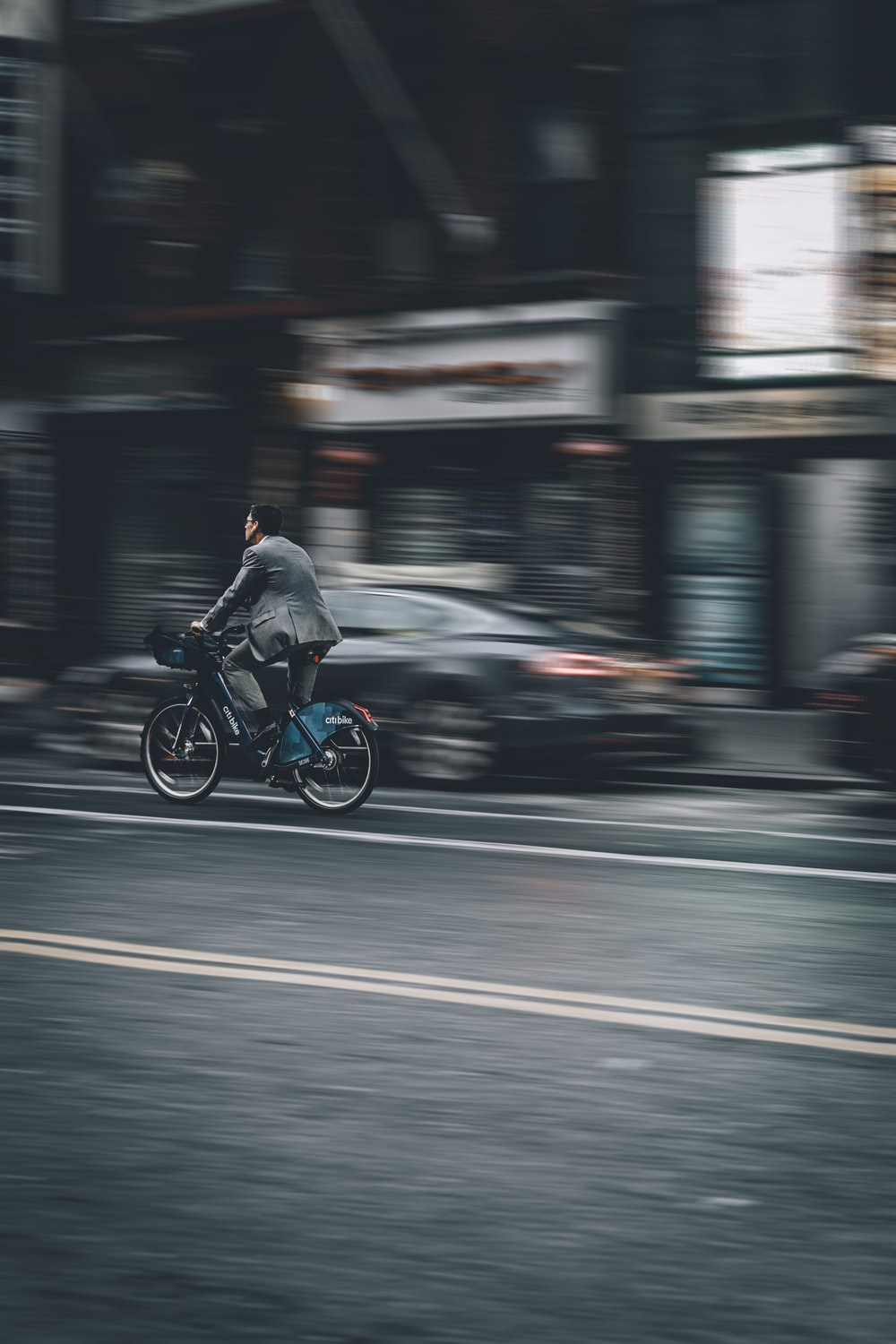 person riding bicycle on road