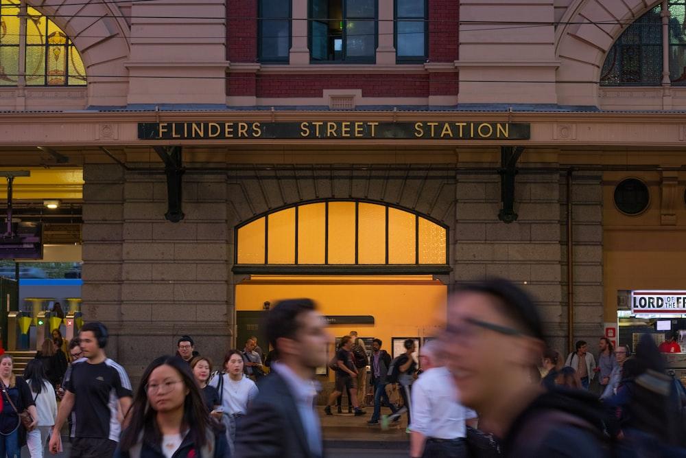people walking near Flinders Street Station building during daytime
