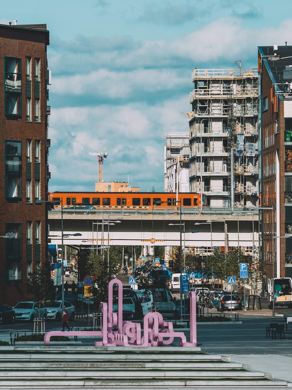 pink frames near buildings