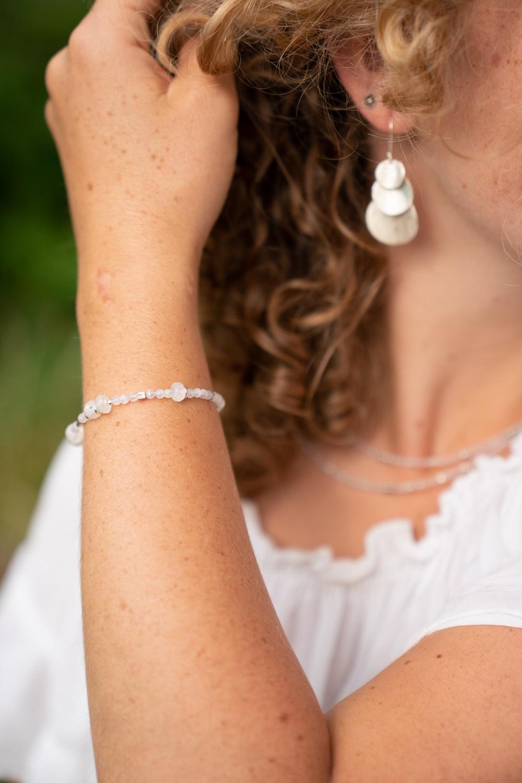 woman wearing silver-color earring