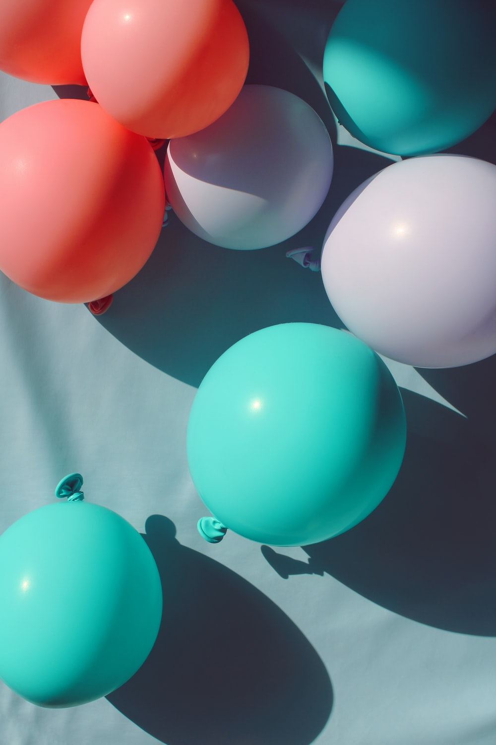 teal, white, and pink balloon