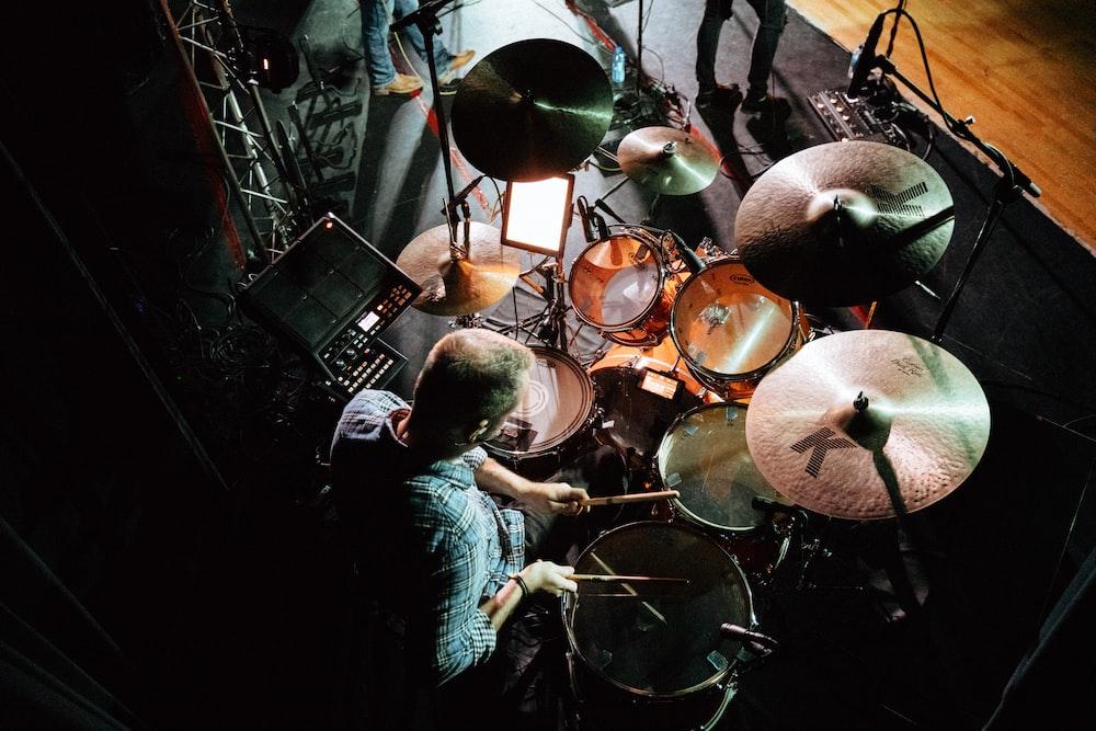 man playing drum set