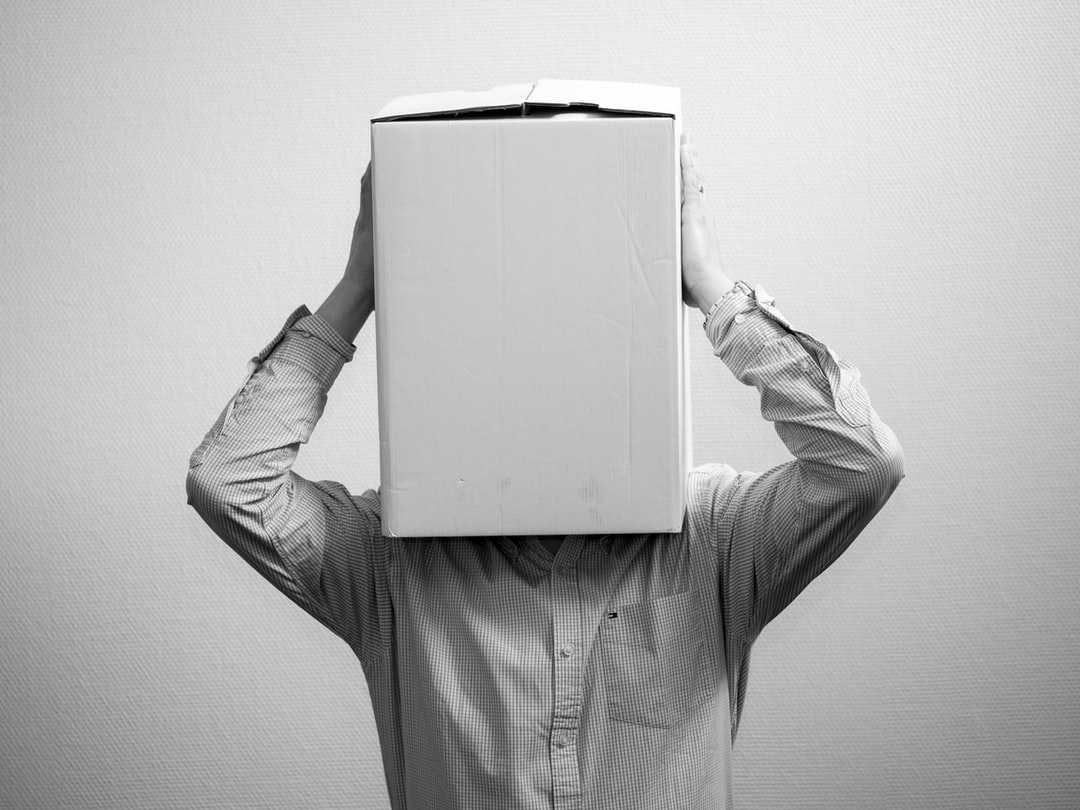 man with a box over his head