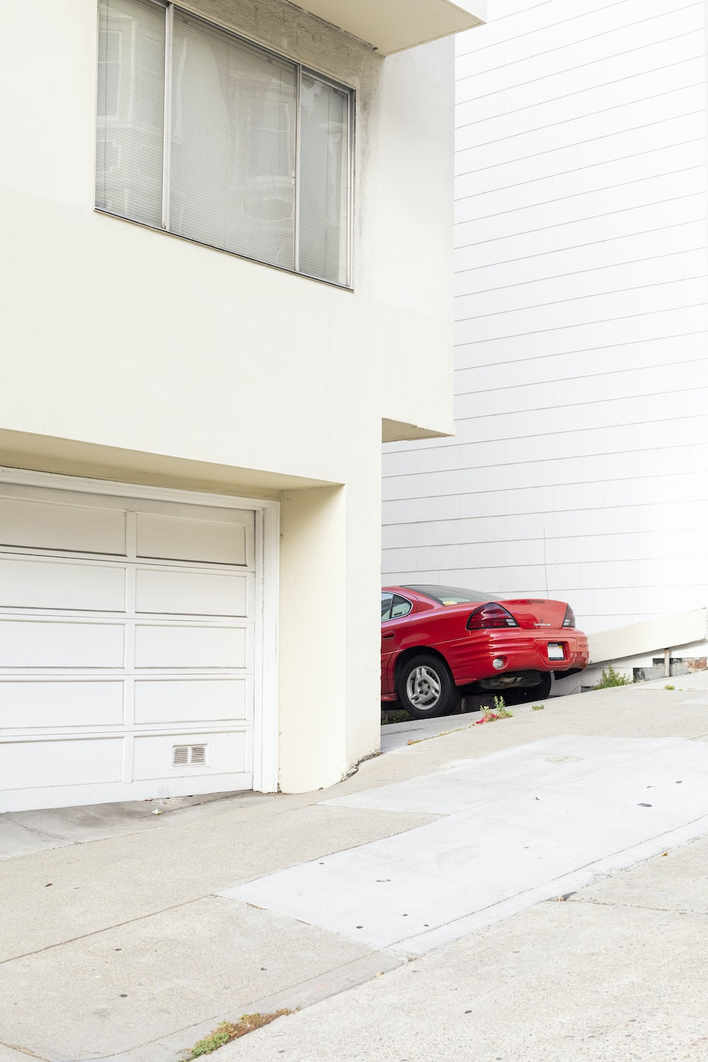 red car beside building