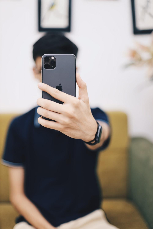 man holding iPhone 11