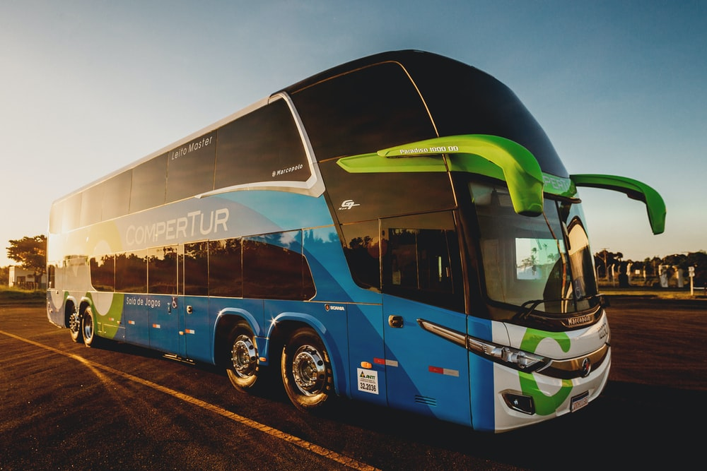 parked blue and black Compertur bus
