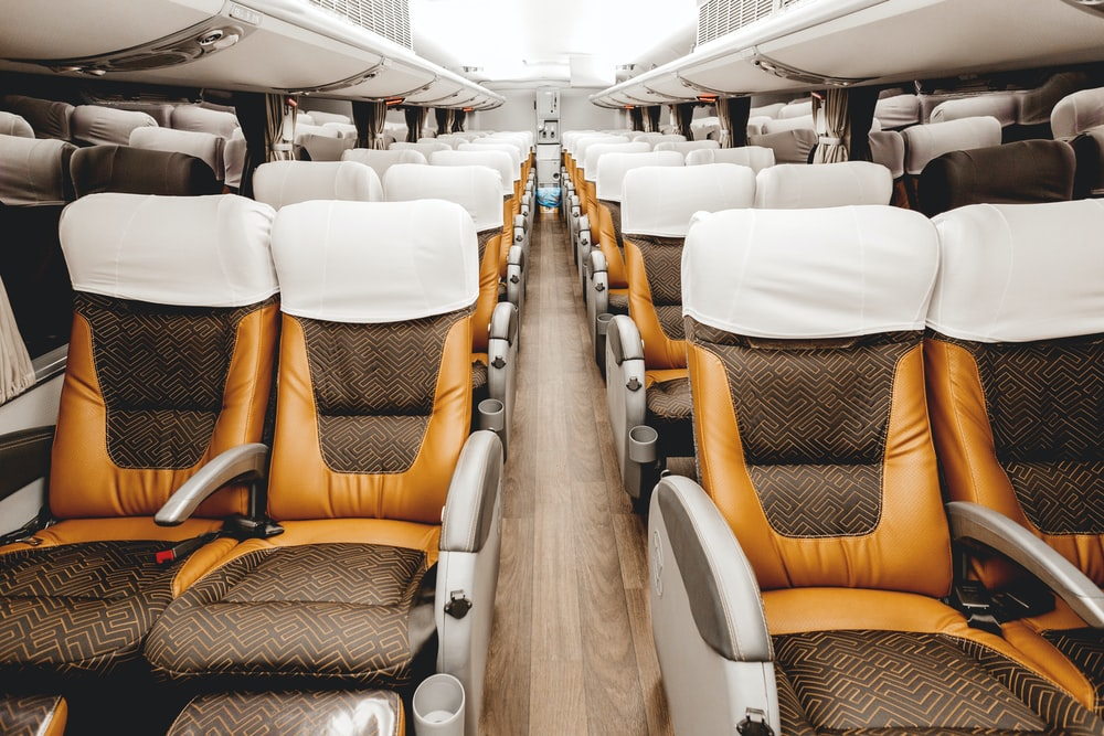 empty brown and white leather airplane seats