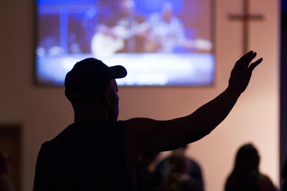 silhouette photo of man inside church