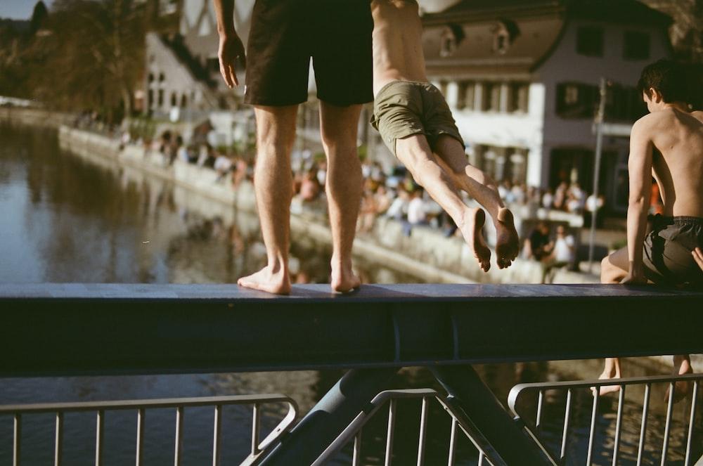 person jumping on bridge