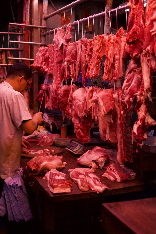 man chopping meat