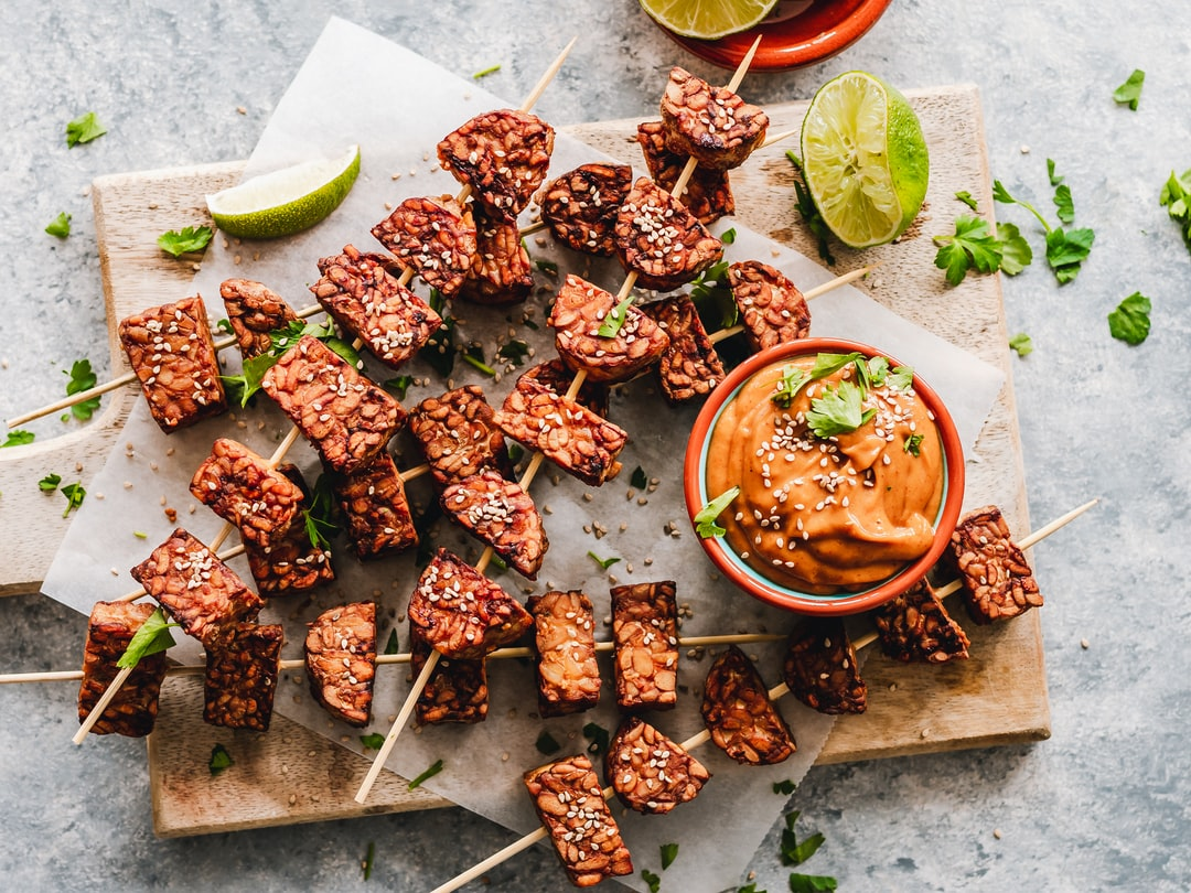 Tempeh is a protein-rich food made from fermented soy beans by Ella Olsson.