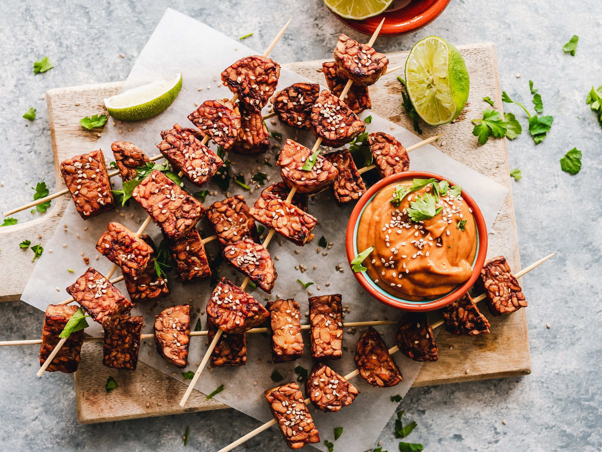 Sesame tempeh skewers with spicy peanut sauce.