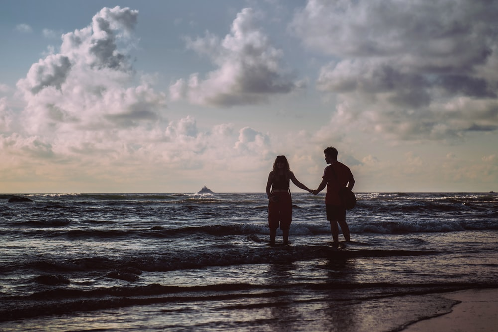 two persons on shore
