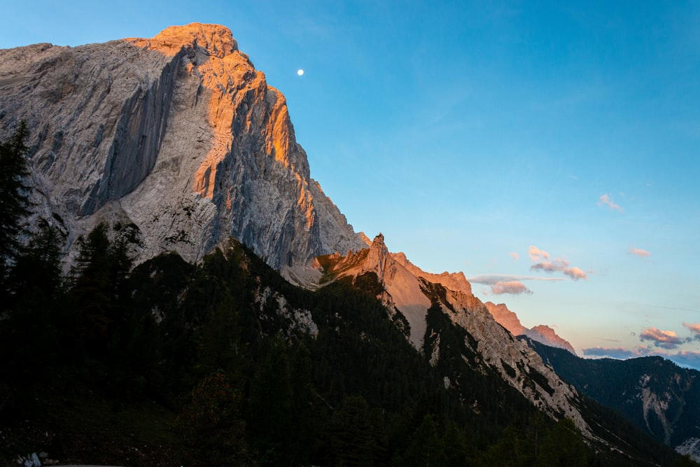 low-angle photography of mountain range under clear blue sky