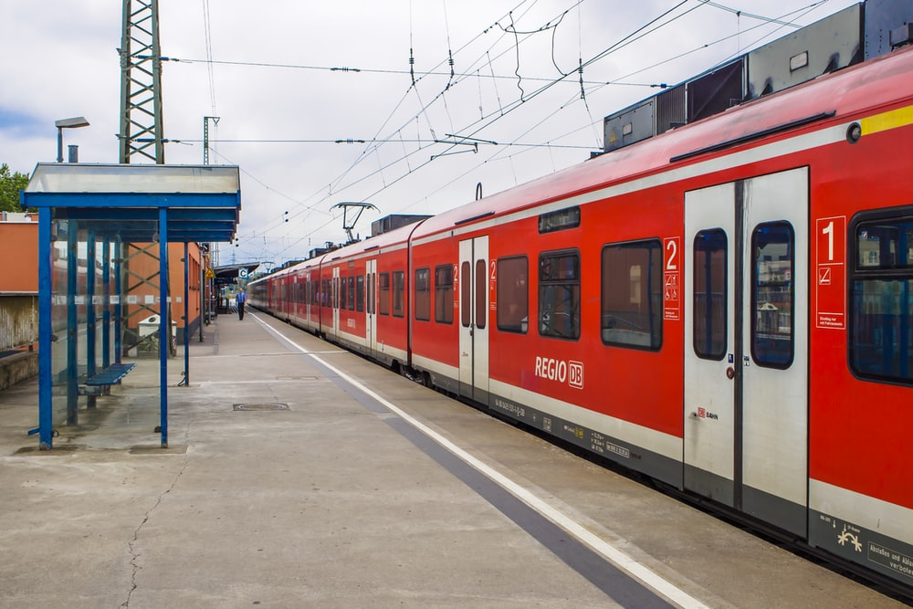 red and white train during daytime