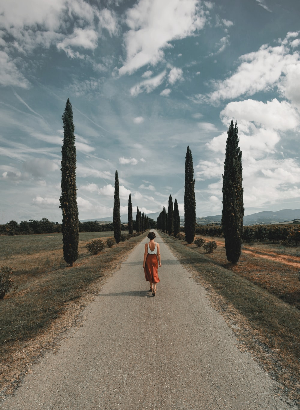 woman standing in the middle of road