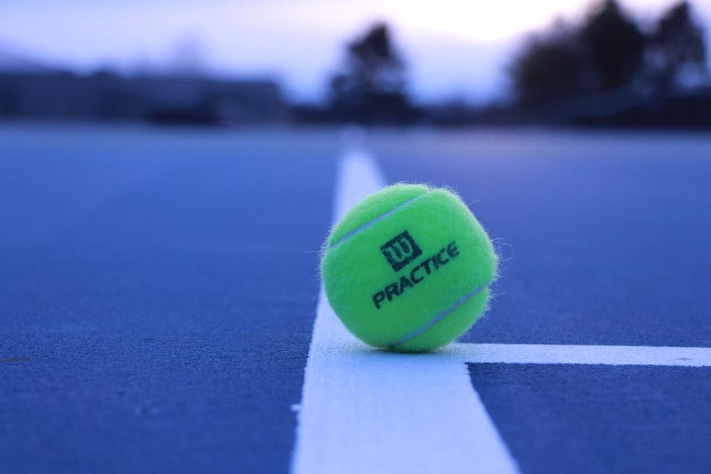 green Wilson practice tennis ball in field