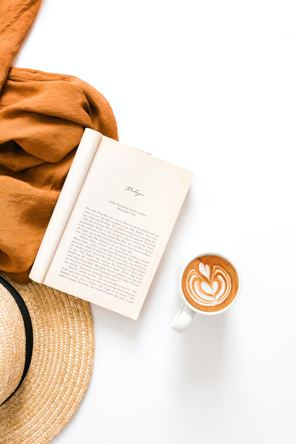printed book and coffee cup