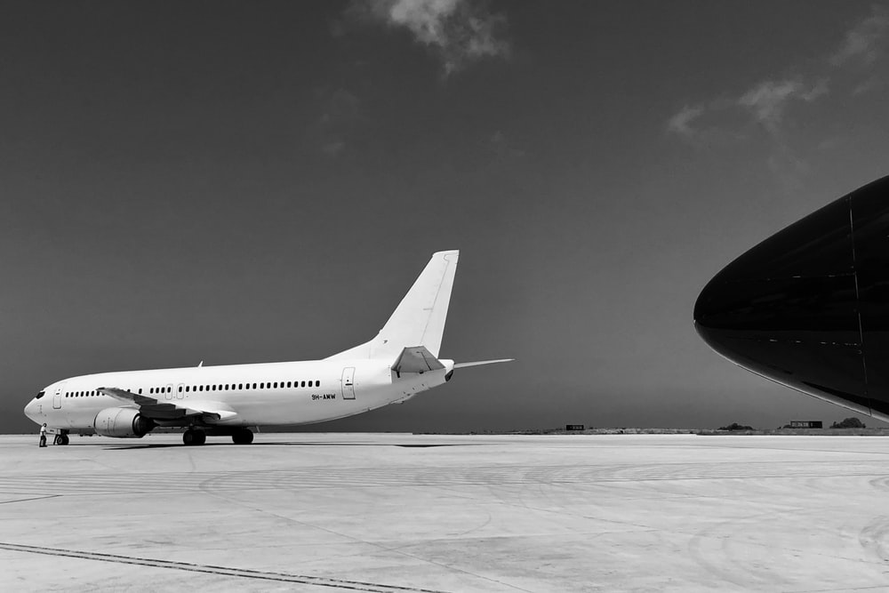 greyscale photography of airplane