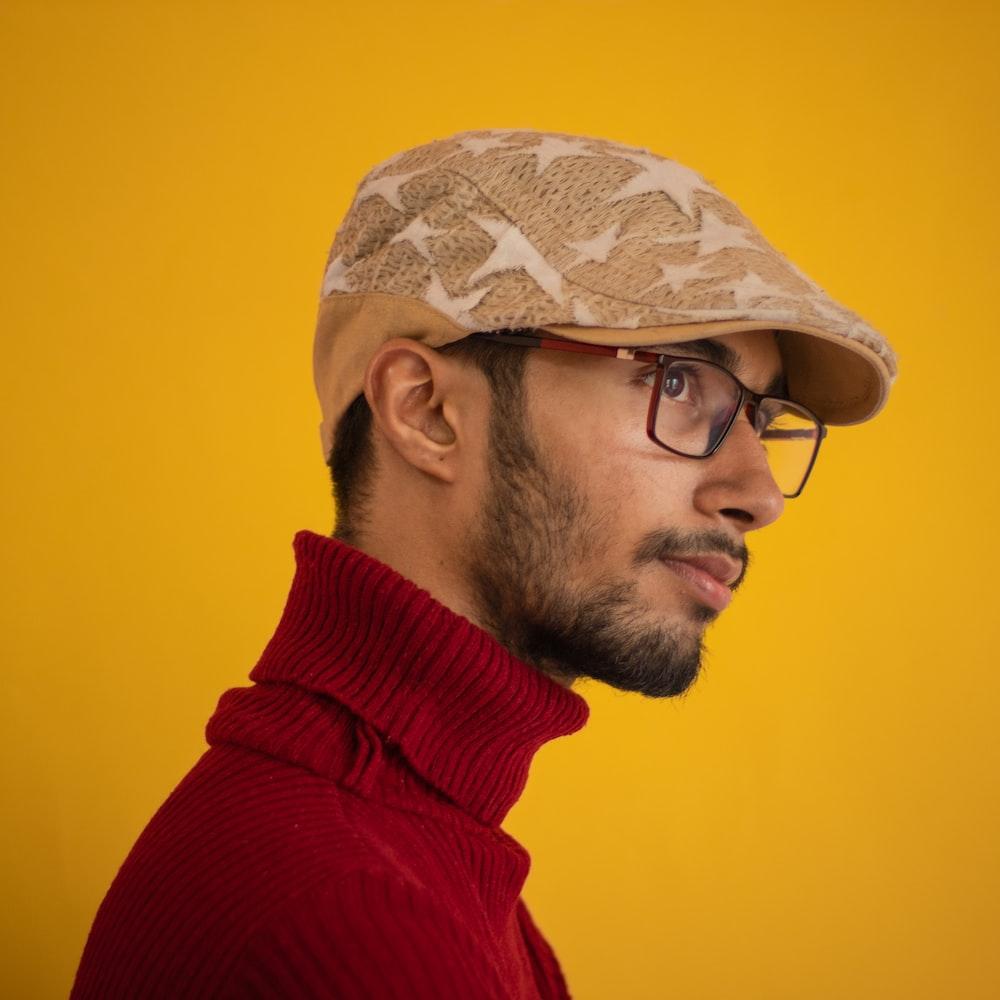 man wearing red turtleneck shirt