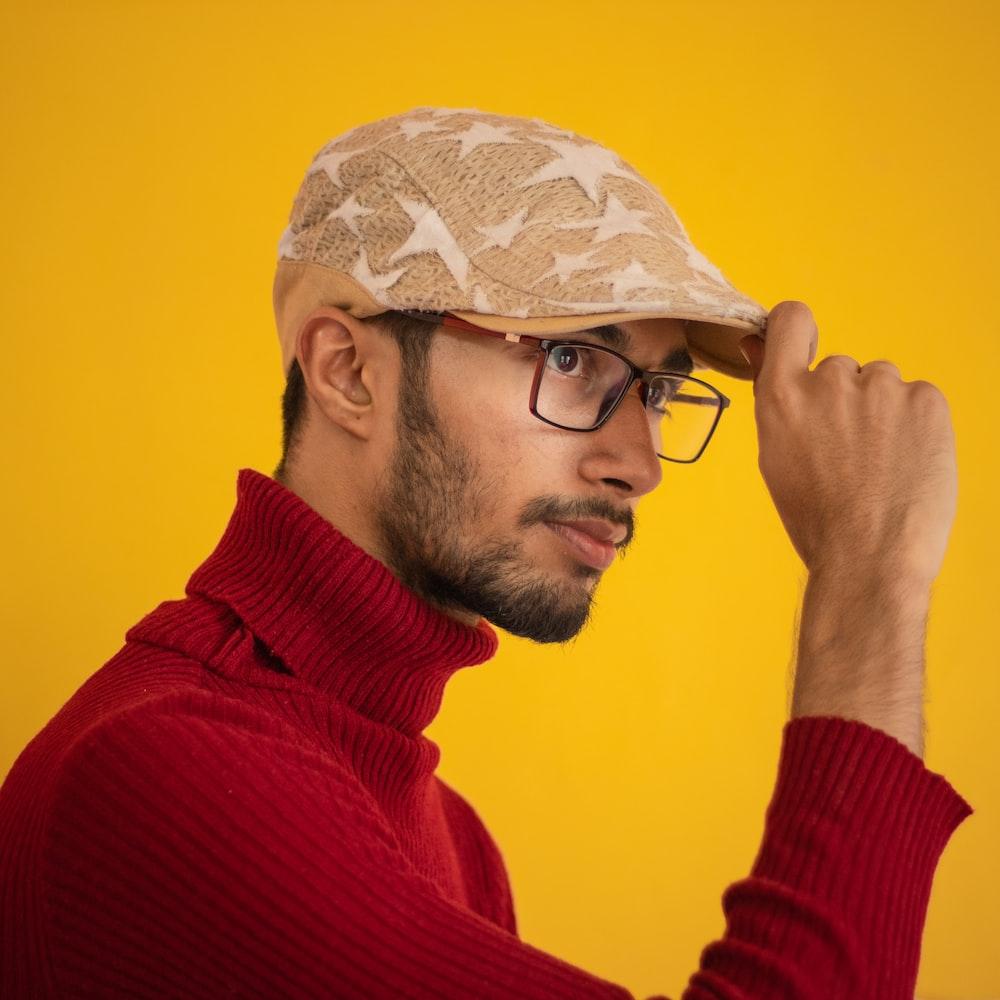 man holding his berret cap