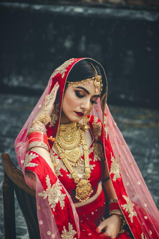 woman wearing wedding sari looking downwards