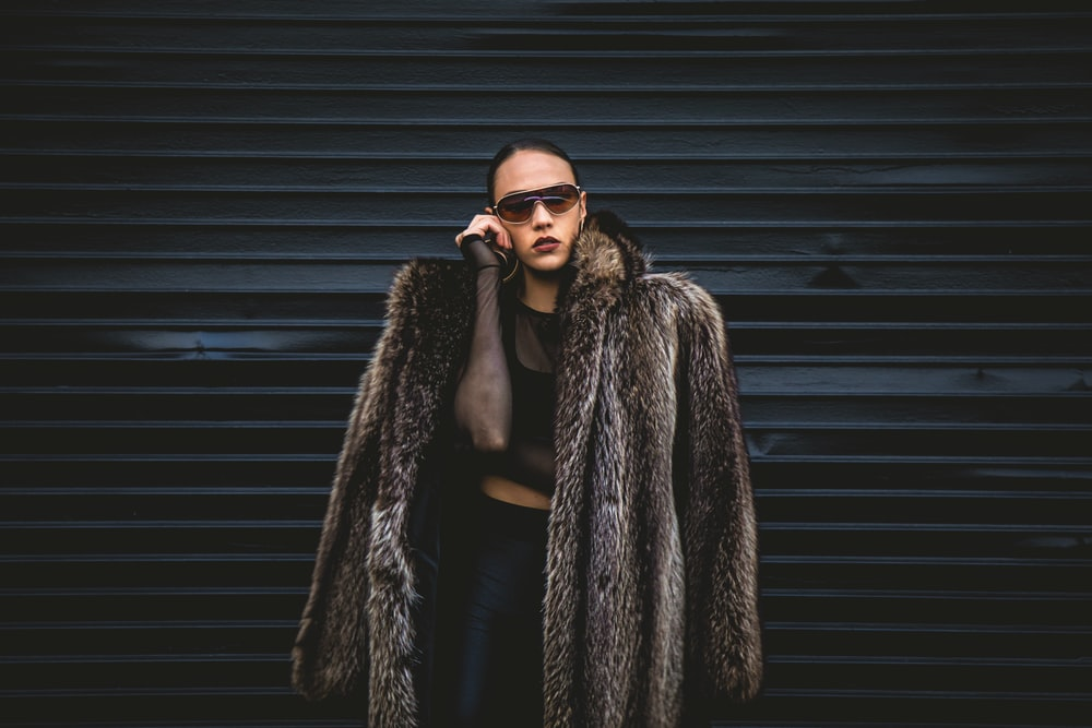 woman wearing brown fur coat