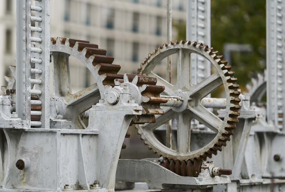 selective focus photography of machine with gears