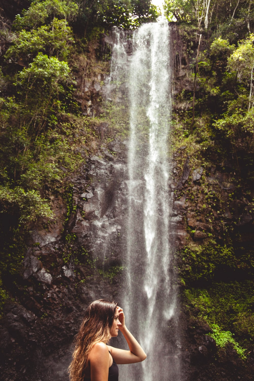 woman wearing black top across waterfalls