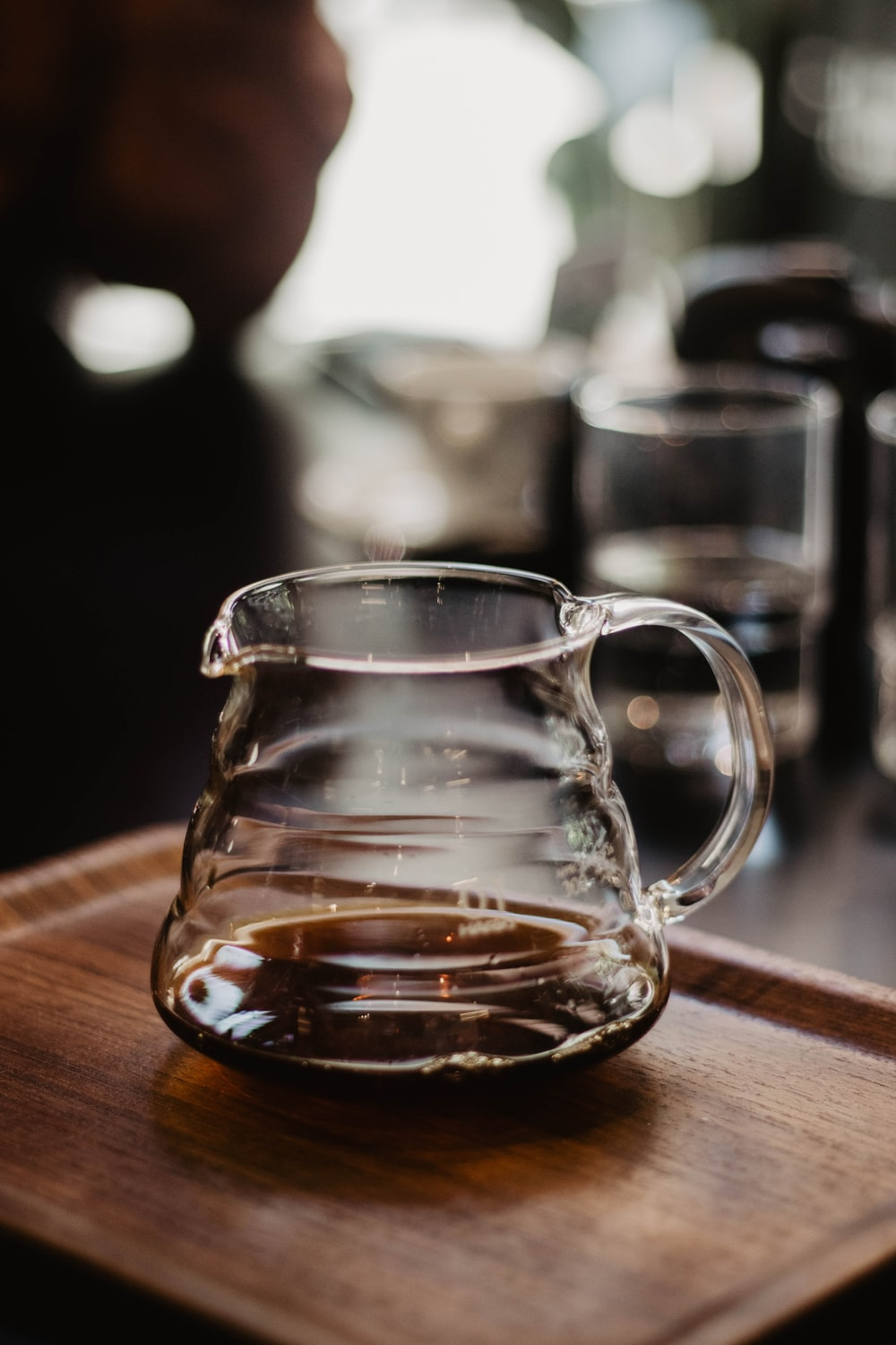 clear glass pitcher in table