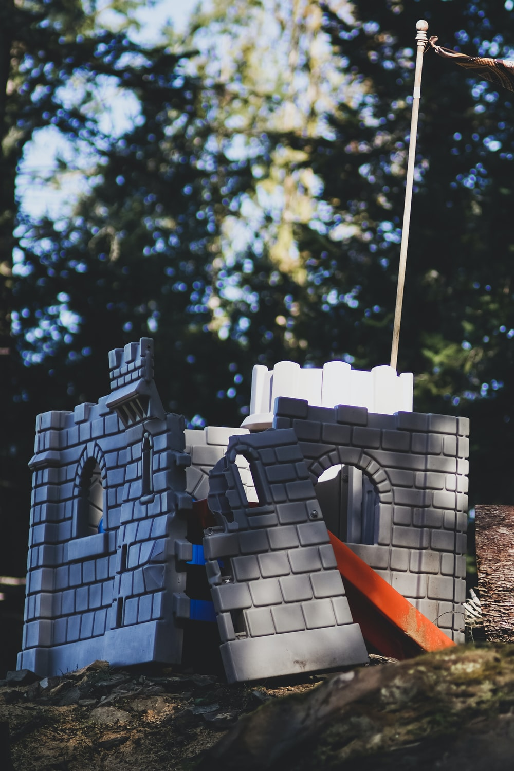 castle playhouse near trees during day