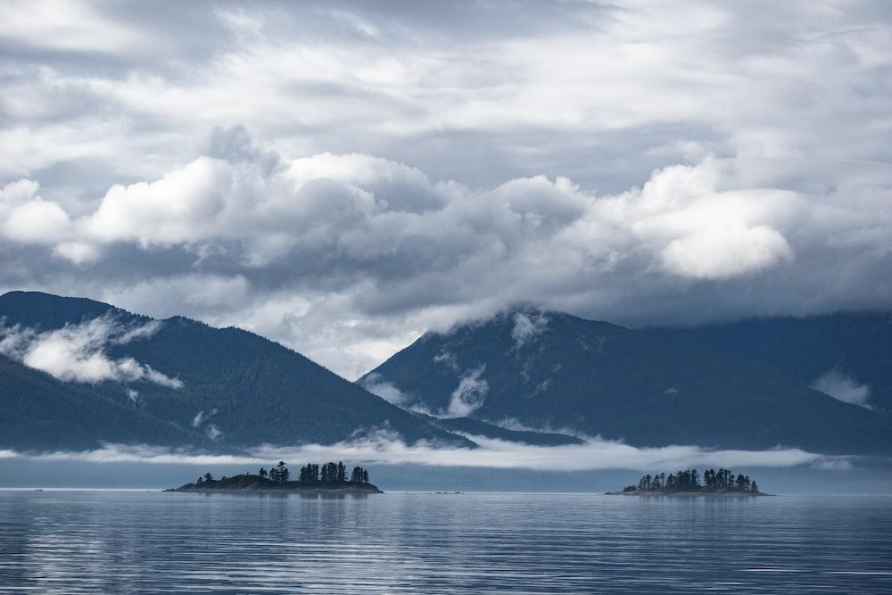 mountain beside ocean